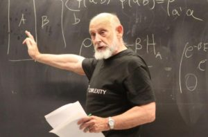 Leonard Susskind lecturing in front of a blackboard